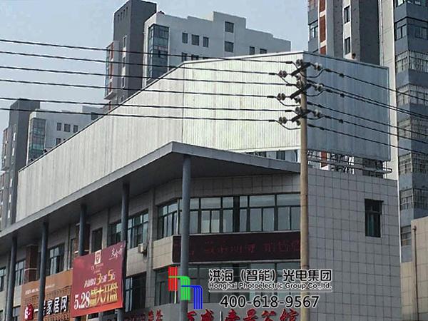 江苏东海楼顶立面三面翻钢架广告牌